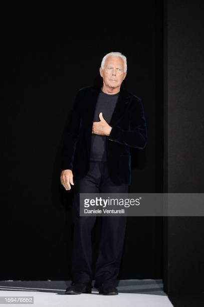 Designer Giorgio Armani acknowledges the applause of the audience after the Emporio Armani show as part of Milan Fashion Week Menswear Autumn/Winter...