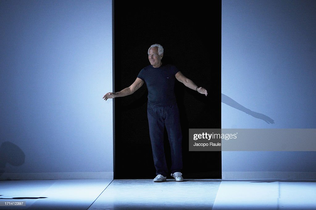 Designer Giorgio Armani acknowledges the applause of the audience after the Emporio Armani show during Milan Menswear Fashion Week Spring Summer 2014 show on June 24, 2013 in Milan, Italy.