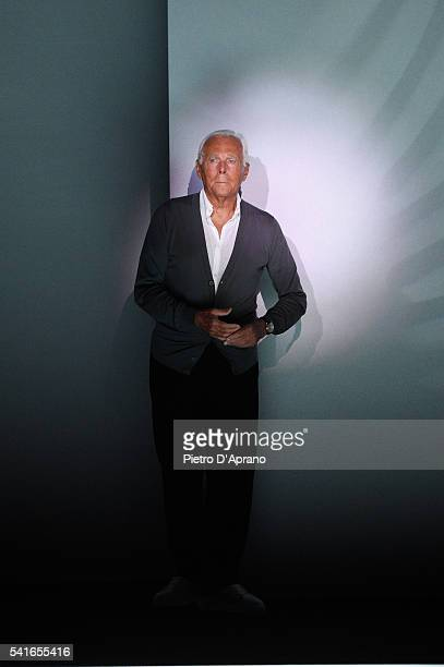 Designer Giorgio Armani acknowledges the applause of the audience after the Emporio Armani show during Milan Men's Fashion Week Spring/Summer 2017 on...