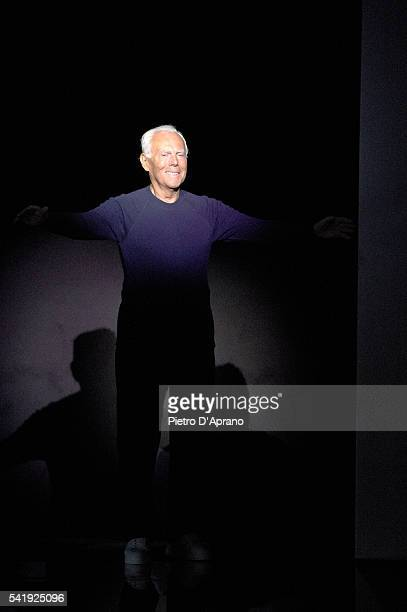 Designer Giorgio Armani acknowledges the applause of the audience after the Giorgio Armani show during Milan Men's Fashion Week Spring/Summer 2017 on...