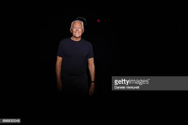 Designer Giorgio Armani acknowledges the applause of the audience after the Emporio Armani show during Milan Men's Fashion Week Spring/Summer 2018 on...