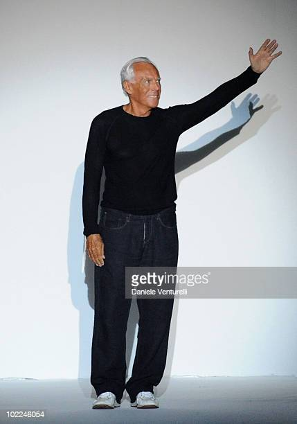 Designer Giorgio Armani acknowledges the applause of the public after the Emporio Armani Milan Menswear Spring/Summer 2011 show on June 20 2010 in...