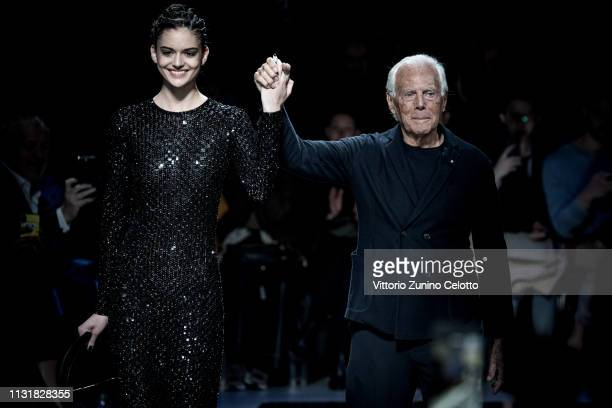 Designer Giorgio Armani acknowledges the applause of the public after the Giorgio Armani show at Milan Fashion Week Autumn/Winter 2019/20 on February...