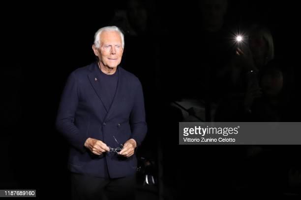 Designer Giorgio Armani acknowledges the applause of the public after the Giorgio Armani Pre-Fall 2020/2021 at Armani Theatre on November 14, 2019 in...