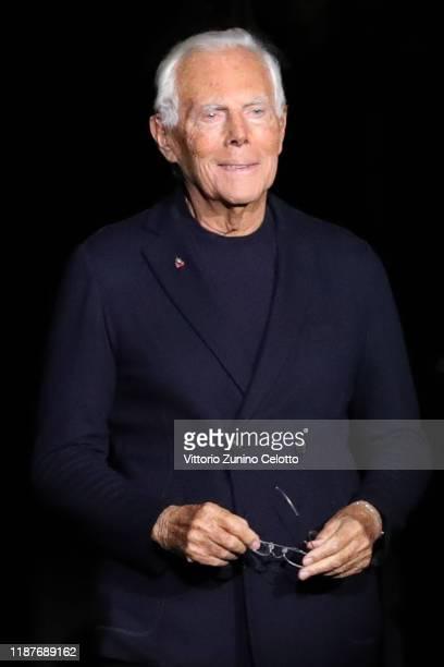 Designer Giorgio Armani acknowledges the applause of the public after the Giorgio Armani PreFall 2020/2021 at Armani Theatre on November 14 2019 in...