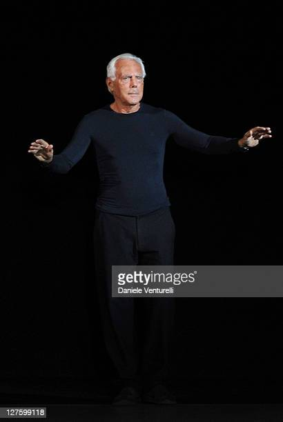 Designer Giorgio Armani acknowledges the applause of the public after the Emporio Armani fashion show as part of Milan Fashion Week Womenswear...