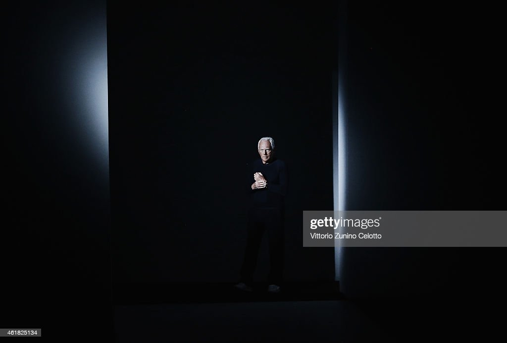 Designer Giorgio Armani acknowledges the applause of the public after the Emporio Armani Show as part of Milan Menswear Fashion Week Fall Winter 2015/2016 on January 19, 2015 in Milan, Italy.