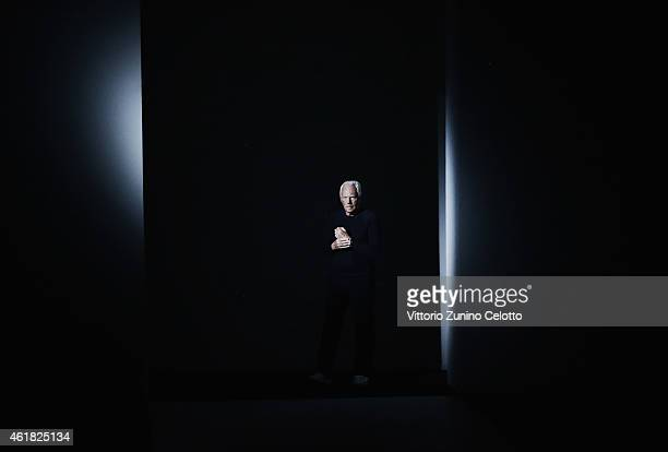 Designer Giorgio Armani acknowledges the applause of the public after the Emporio Armani Show as part of Milan Menswear Fashion Week Fall Winter...