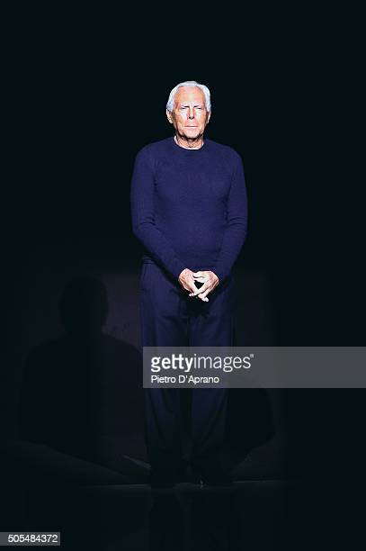 Designer Giorgio Armani acknowledges the applause of the public after the the Emporio Armani show during Milan Men's Fashion Week Fall/Winter 2016/17...
