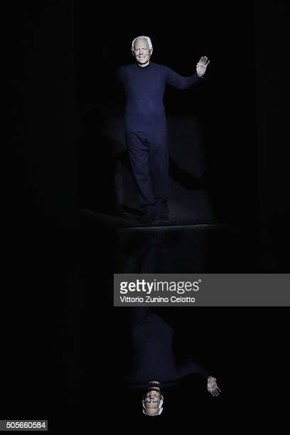 Designer Giorgio Armani acknowledges the applause of the public after the Giorgio Armani show during Milan Men's Fashion Week Fall/Winter 2016/17 on...