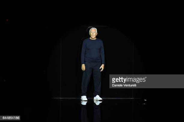Designer Giorgio Armani acknowledges the applause of the public after the Emporio Armani show during Milan Fashion Week Fall/Winter 2017/18 on...