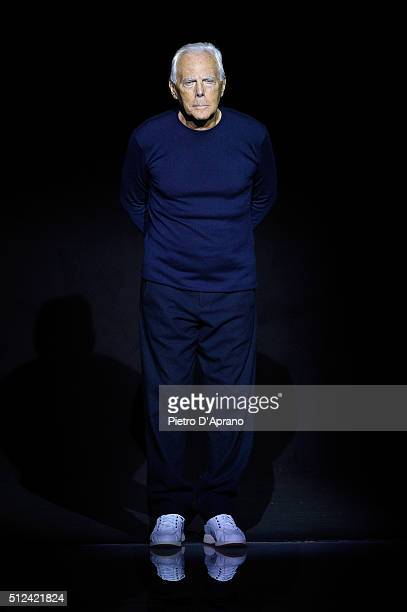 Designer Giorgio Armani ackowledges the applause of the audience after the Emporio Armani show during Milan Fashion Week Fall/Winter 2016/17 on...