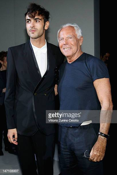 Designer Giorgio Armani and singer Marco Mengoni attend the Emporio Armani show as part of Milan Fashion Week Menswear Spring/Summer 2013 on June 25,...