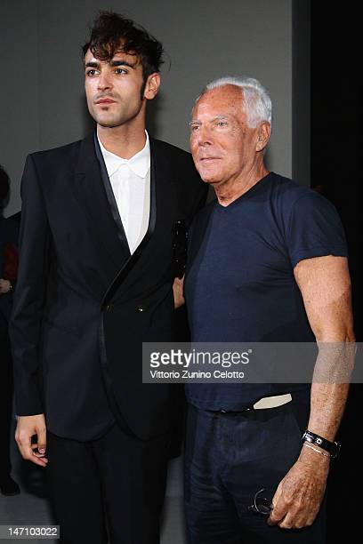Designer Giorgio Armani and singer Marco Mengoni attend the Emporio Armani show as part of Milan Fashion Week Menswear Spring/Summer 2013 on June 25...