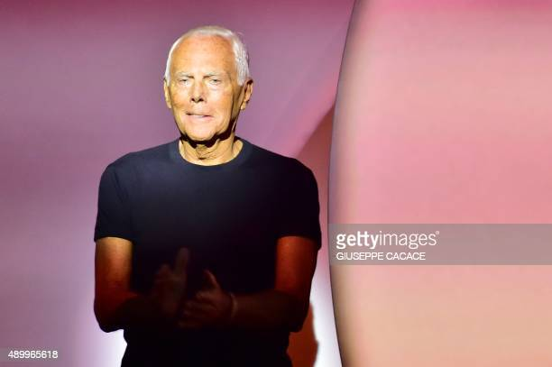 Designer Giorgio Armani greets the audience at the end of the show for fashion house Emporio Armani during the women Spring / Summer 2016 Milan's...