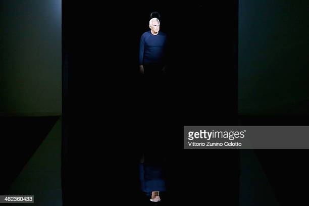 Designer Giorgio Armani on the runway after his show as a part of Milan Fashion Week Menswear Autumn/Winter 2014 on January 13 2014 in Milan Italy