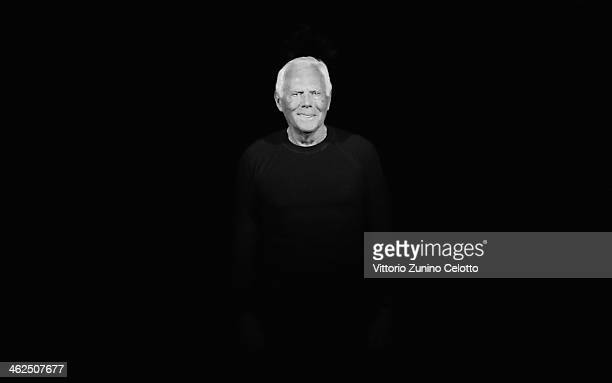 Designer Giorgio Armani on the runway after his show as a part of Milan Fashion Week Menswear Autumn/Winter 2014 on January 13, 2014 in Milan, Italy.