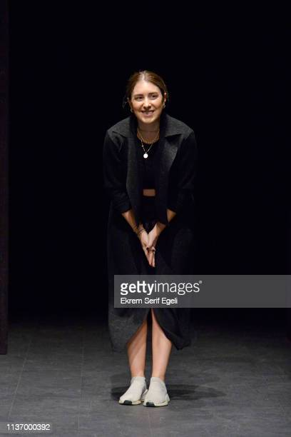 Designer Gizem Ogan Yazgan acknowledges the applause of the audience after the House Of Ogan show during MercedesBenz Istanbul Fashion Week at the...
