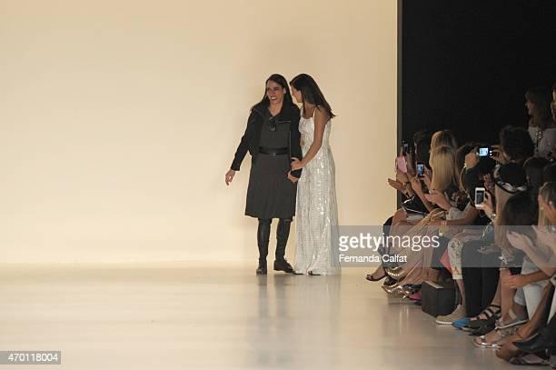 Designer Gloria Coelho and actress Isis Valverde walk the Gloria Coelho Runway at SPFW Summer 2016 at Parque Candido Portinari on April 17 2015 in...