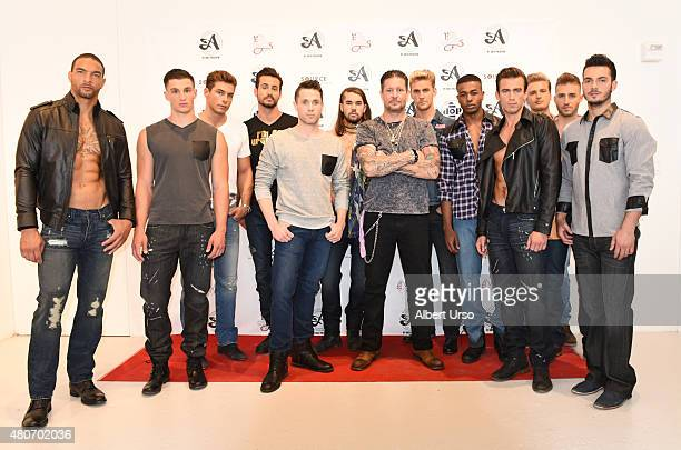 Designer Greg Polessini poses with models at the Artistix by Greg Polessini presentation during New York Fashion Week Men's SS16 at Rogue Space on...