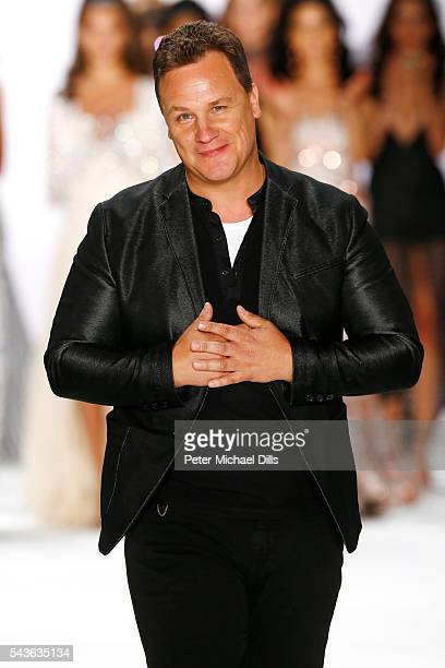 Designer Guido Maria Kretschmer acknowledges the applause of the audience at the runway after his show during the MercedesBenz Fashion Week Berlin...