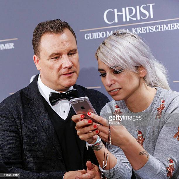 Designer Guido Maria Kretschmer and a editor of InStyle magazine Germany attend the 'Gluecksmuenz' collection launch by Guido Maria Kretschmer at...