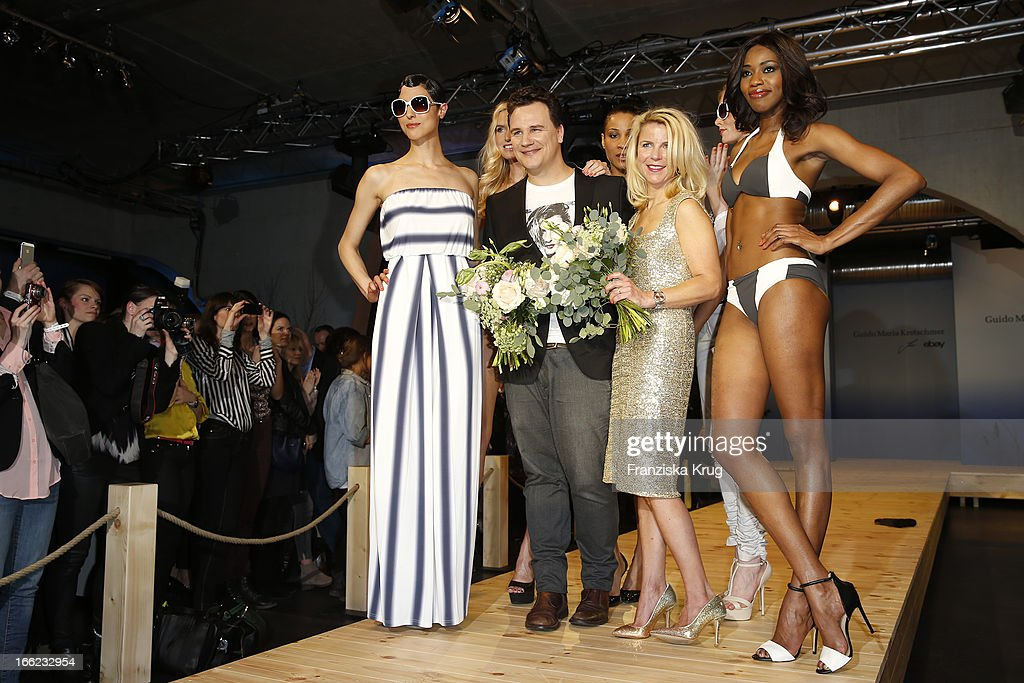 Designer Guido Maria Kretschmer and Leonie Bechtoldt pose with models at the Guido Maria Kretschmer For eBay Collection Launch at Label 2 on April 10, 2013 in Berlin, Germany.