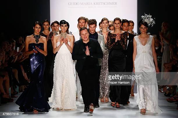 Designer Guido Maria Kretschmer and models pose on the runway after the Guido Maria Kretschmer show during the MercedesBenz Fashion Week Berlin...