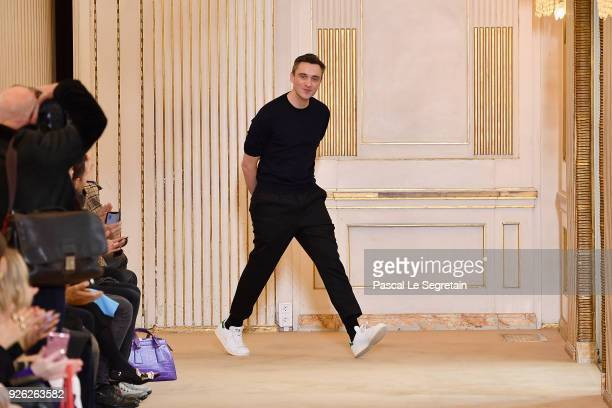 Designer Guillaume Henry walks the runway during the Nina Ricci show as part of the Paris Fashion Week Womenswear Fall/Winter 2018/2019 on March 2...