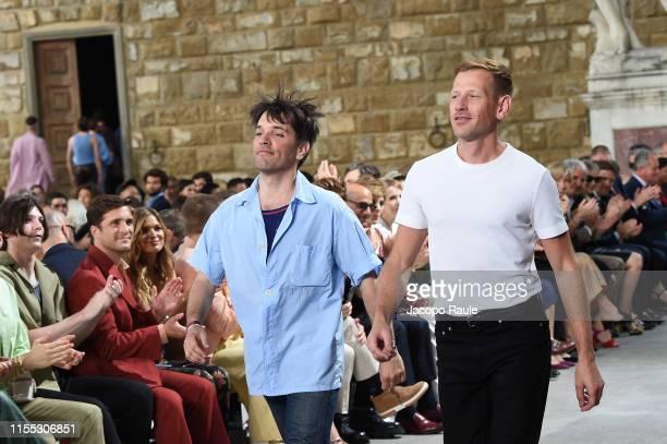 Designer Guillaume Meilland and Paul Andrew walk the runway at the Salvatore Ferragamo fashion show in Piazza della Signoria during Pitti Immagine...