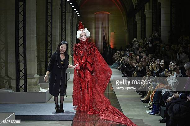 Designer Guo Pei and Carmen Dell'Orefice walk the runway during the Guo Pei Spring Summer 2017 show as part of Paris Fashion Week on January 25, 2017...