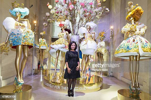 Designer Guo Pei poses during the 'Guo Pei Collaborates with Mac Cosmetics' event at Musee Des Arts Decoratifs on July 7 2015 in Paris France