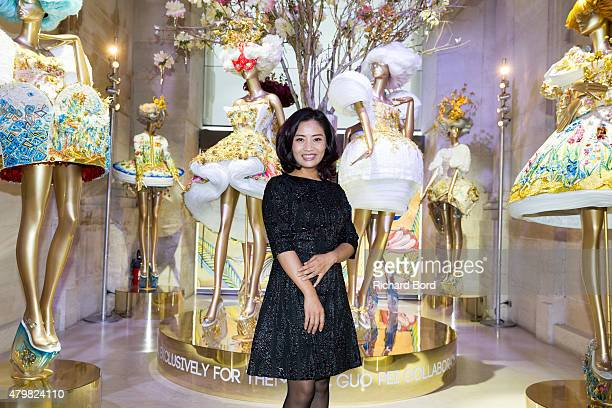 Designer Guo Pei poses during the 'Guo Pei Collaborates with Mac Cosmetics' event at Musee Des Arts Decoratifs on July 7, 2015 in Paris, France.
