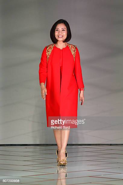 Designer Guo Pei walks the runway during the Guo Pei Spring Summer 2016 show as part of Paris Fashion Week on January 27 2016 in Paris France