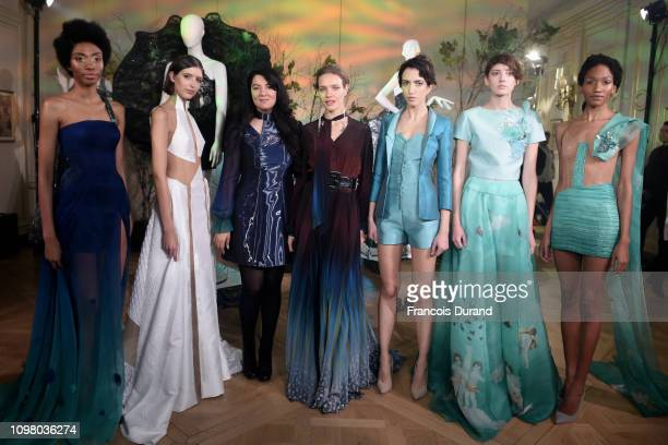 Designer Gyunel Rustamova and Natalia Vodianova pose with models after Gyunel presentation at the Ritz Hotel on January 22 2019 in Paris France