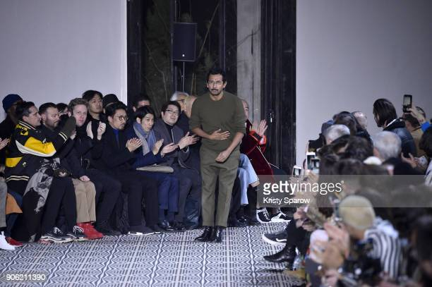 Designer Haider Ackermann acknowledges the audience during the Haider Ackermann Menswear Fall/Winter 20182019 show as part of Paris Fashion Week on...