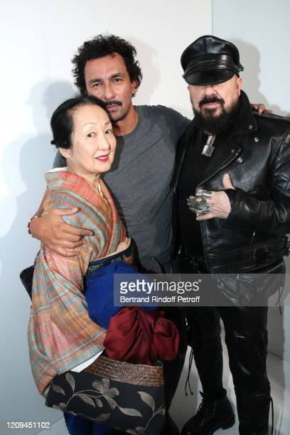 Designer Haider Ackermann standing between Setsuko Klossowska de Rola and Peter Marino pose after the Haider Ackermann show as part of the Paris...
