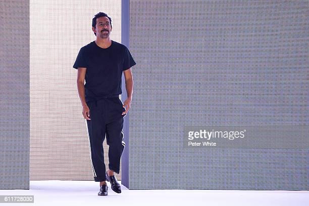 Designer Haider Ackermann walks the runway after the Haider Ackermann show as part of the Paris Fashion Week Womenswear Spring/Summer 2017 on October...