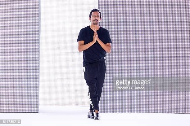 Designer Haider Ackermann walks the runway during the Haider Ackermann show as part of the Paris Fashion Week Womenswear Spring/Summer 2017 on...