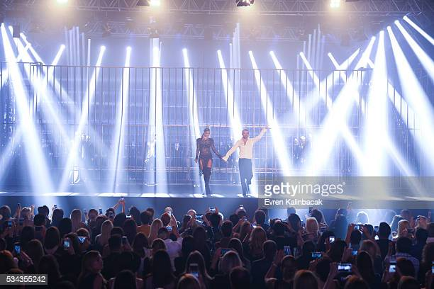 Designer Hakan Akkaya and Model Cagla Sikel appears on the runway after the the Hakan Akkaya Fall/Winter 16/17 fashion show at Maslak Arena on May 25...