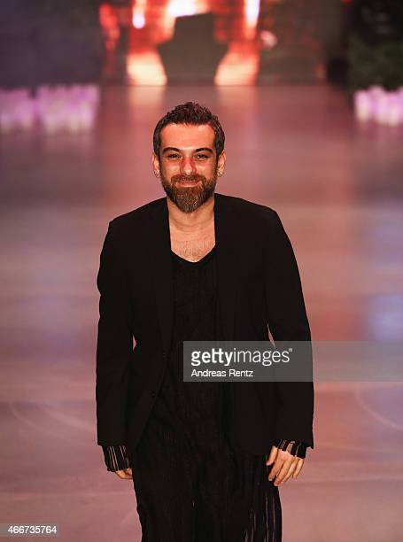 Designer Hakan Akkaya attends his show during Mercedes Benz Fashion Week Istanbul FW15 on March 18 2015 in Istanbul Turkey