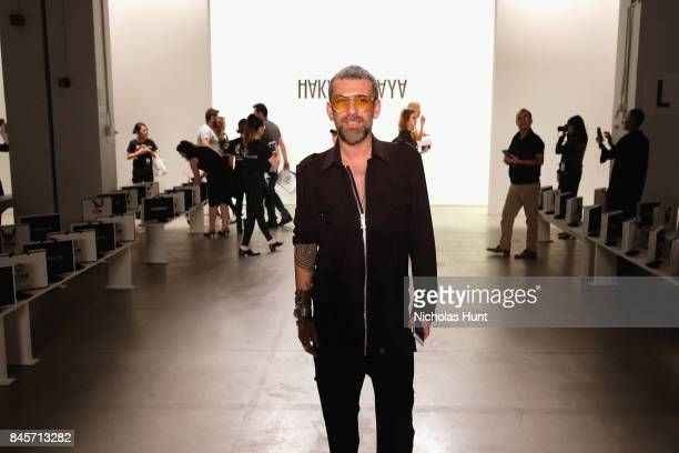 Designer Hakan Akkaya prepares backstage for Hakan Akkaya fashion show during New York Fashion Week The Shows at Gallery 2 Skylight Clarkson Sq on...