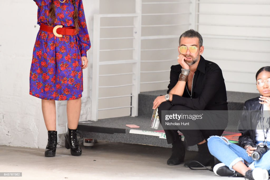 Designer Hakan Akkaya watches the rehearsal of the Hakan Akkaya fashion show during New York Fashion Week: The Shows at Gallery 2, Skylight Clarkson Sq on September 11, 2017 in New York City.