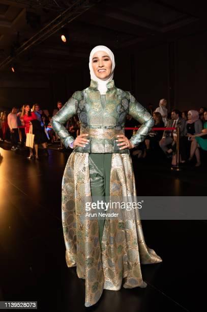 Designer Hama Yassen poses on the runway during Jordan Fashion Week at the Kempinski Hotel Amman on March 30 2019 in Amman Jordan