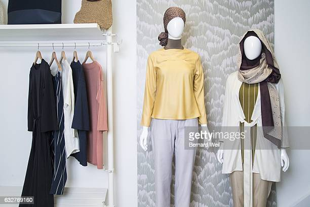 Designer Hana Tajima displays various pieces in her collection of modest wear. Uniqlo is getting ready to debut a line of modest-wear for women in...