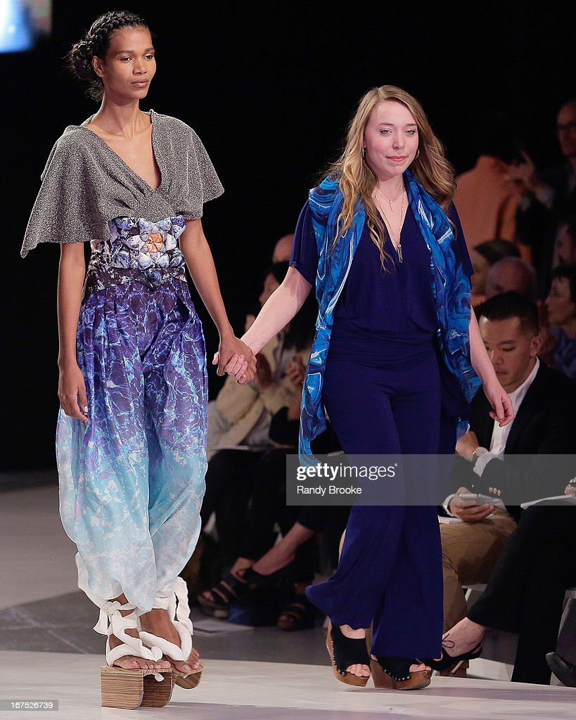 Designer Hannah Ross (r) walks the runway with a model wearing one of her designs at the 114th Annual Pratt Institute Fashion Show at Center 548 on April 25, 2013 in New York City.