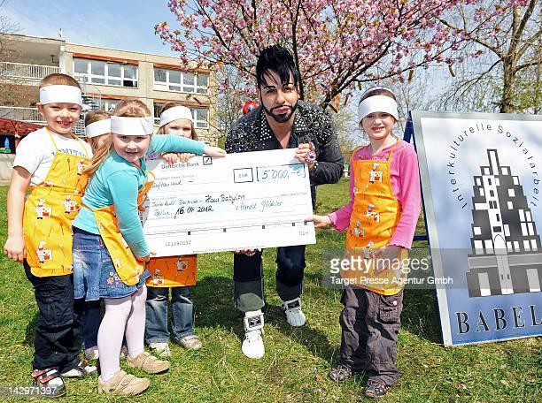 Designer Harald Gloeoeckler hands over a 5000 euro cheque to the 'Deutsches Kinderhilfswerk' in a Kindergarden in Berlin-Hellersdorf on April 16,...