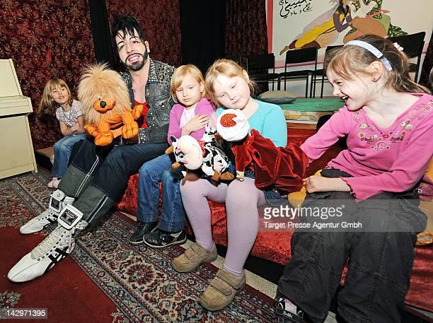 Designer Harald Gloeoeckler plays with children after he handed over a 5000 euro cheque to the 'Deutsches Kinderhilfswerk' in a Kindergarden in...