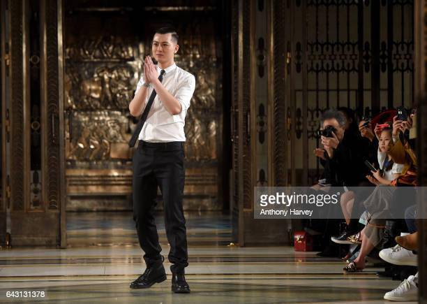 Designer Harry Xu salutes the crowd following the Harry Xu show during the London Fashion Week February 2017 collections on February 20 2017 in...