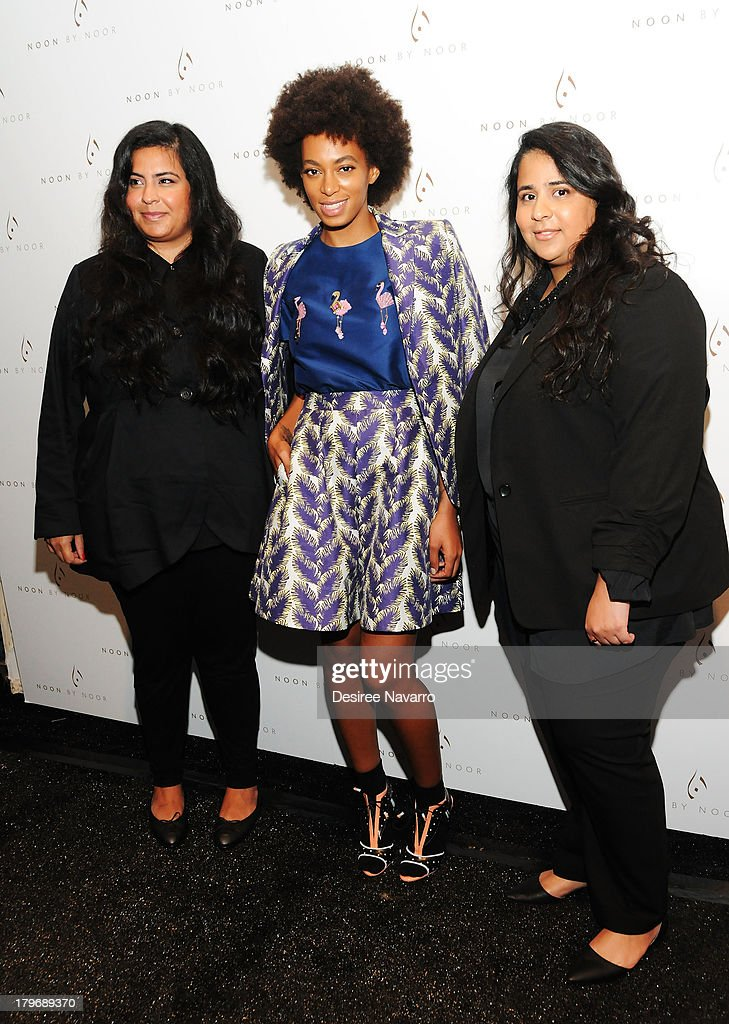 Designer Haya Mohammed Al Khalifa, singer Solange, and designer Noor Rashid Al Khalifa pose for photos backstage at the Noon By Noor show during Spring 2014 Mercedes-Benz Fashion Week at The Studio at Lincoln Center on September 6, 2013 in New York City.